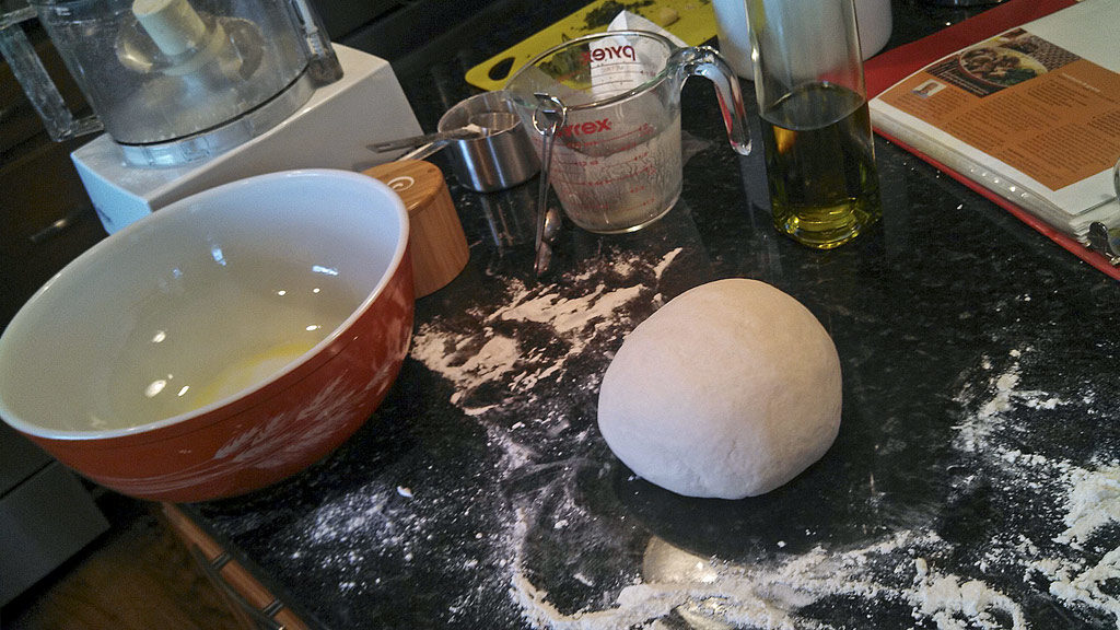 ball of dough on messy kitchen counter