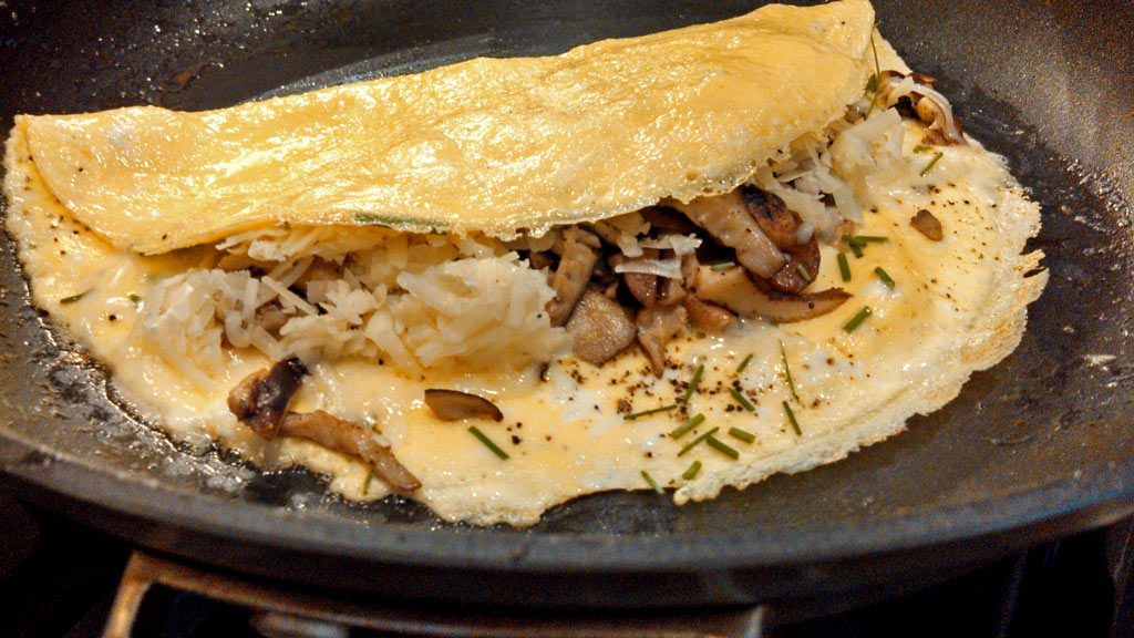 These shiitake mushroom omelettes with cheese are made with farm fresh eggs, filled with earthy shiitake mushrooms, cheese and fresh chives. | TheMountainKitchen.com