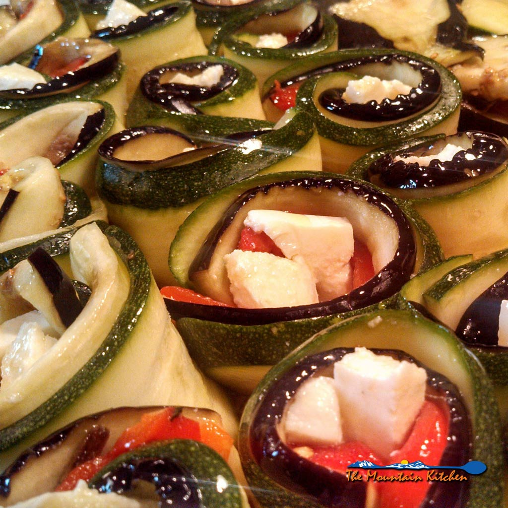 Ratatouille spirals are made of sliced eggplant, zucchini, roasted red peppers, creamy mozzarella cheese, and anchovies, rolled and baked in tomato sauce. | TheMountainKitchen.com