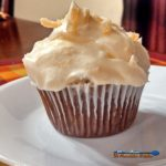 These molasses rich gingerbread cupcakes are infused with warm crystallized ginger, topped with a zesty and fresh orange cream cheese frosting. | TheMountainKitchen.com