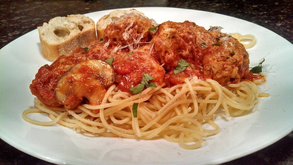 mouthwatering meatballs with spaghetti drenched in sauce