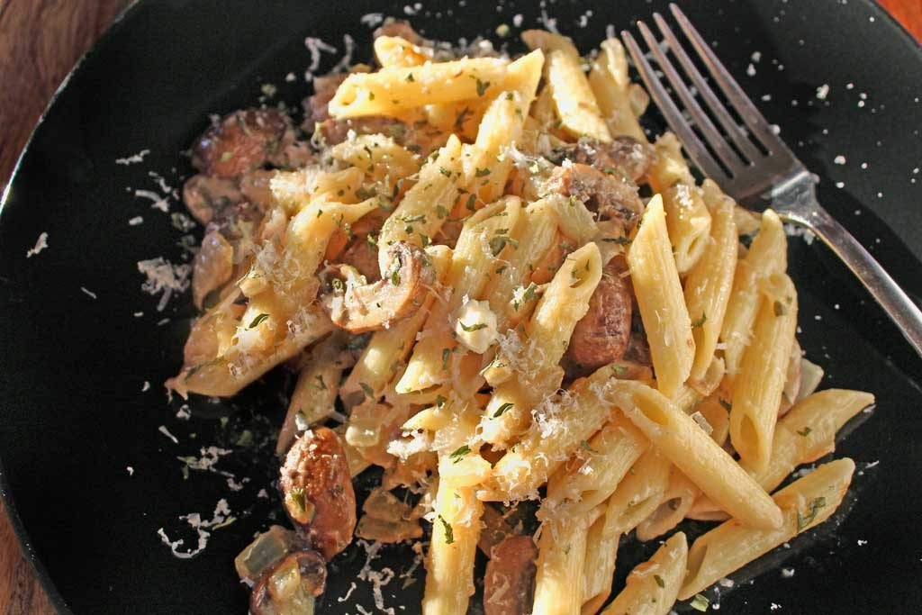 Penne pasta piled high on plate