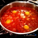 Eggs in hell consists of eggs poached in a hot and spicy tomato sauce. The perfect amount of heat and spice mixed with the warm richness of the egg. | TheMountainKitchen.com