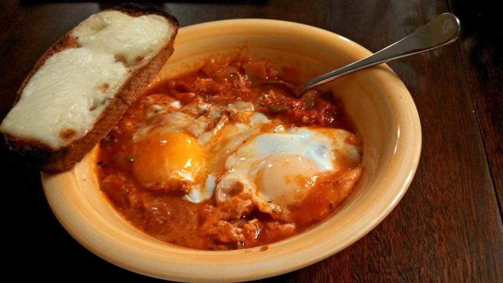 Eggs in hell in a bowl with bread