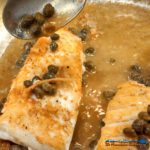 Halibut fillets with a caper butter sauce made of capers, garlic, wine and butter. Make a romantic meal in just 25 minutes.   TheMountainKitchen.com