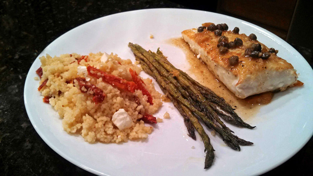 Halibut on plate with asparagus and couscous