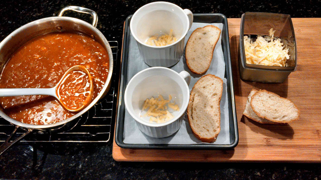bowls with bread and cheese ready for soup