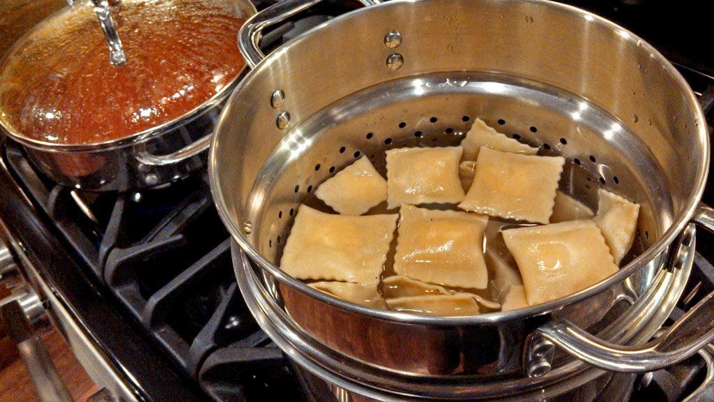 boiling pasta in pasta pot