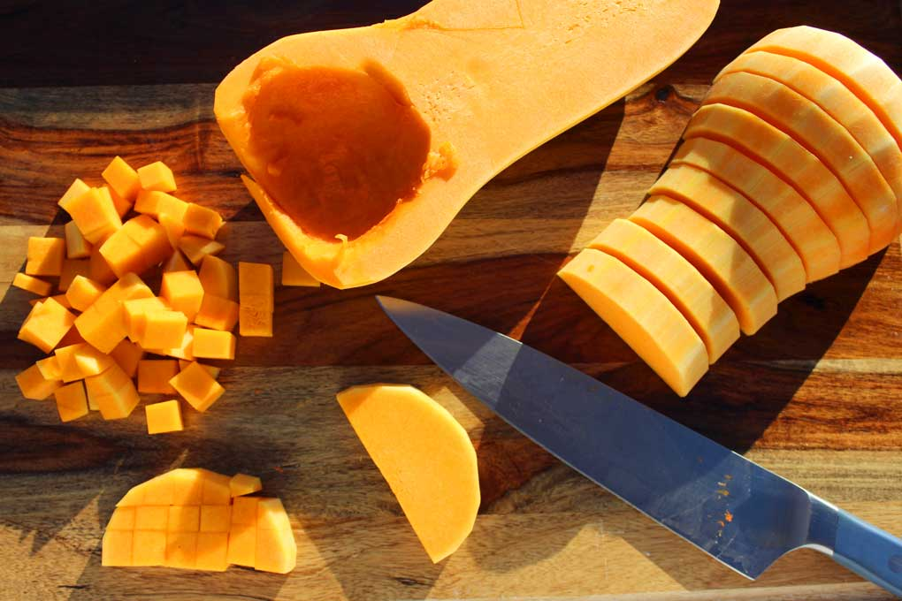 butternut squash cut on cutting board