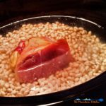 These slow-cooker navy beans are seasoned with smoky ham hock, slow cooked into a rich creamy pot of beans. A hearty meal on a cold winter day! | TheMountainKitchen.com