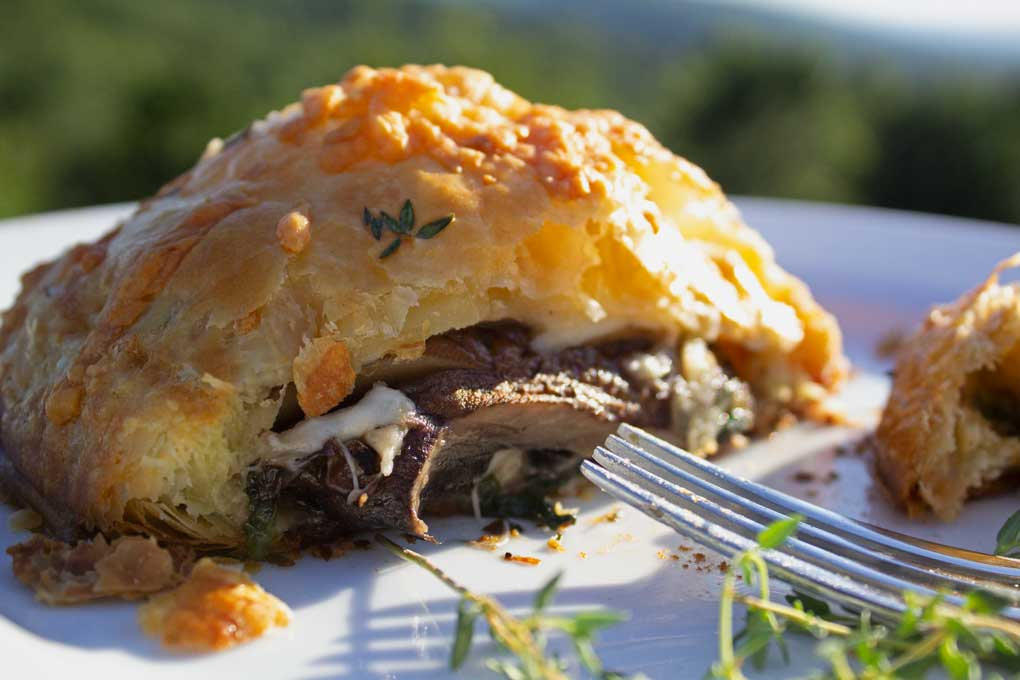 mushroom wellington with fork and mountain view