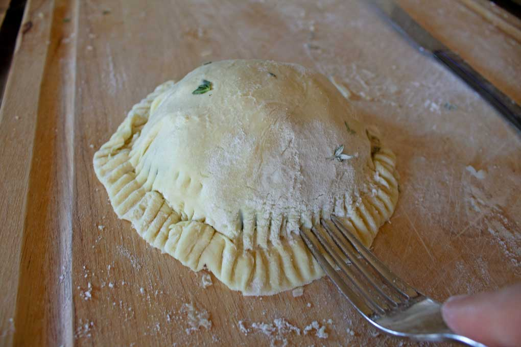 crimping pastry dough with fork