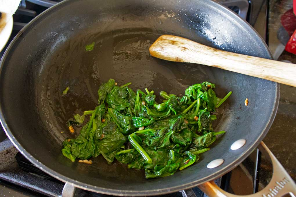 cooked spinach in skillet