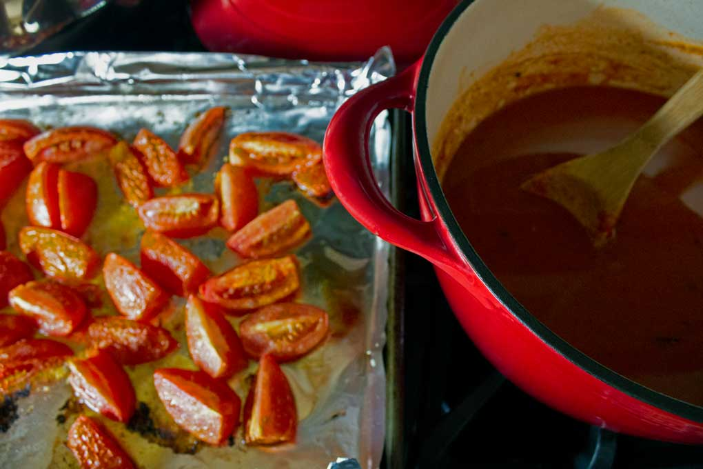 sheet pan of tomatoes and pot of soup