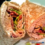 Turkey bacon club wraps made with oven roasted turkey breast topped with bacon lettuce and tomatoes wrapped inside a sandwich wrap. Absolutely delicious! | TheMountainKitchen.com