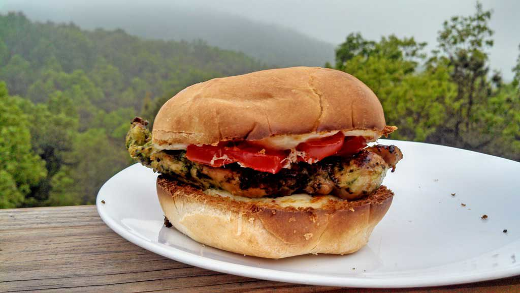 Grilled Cilantro Pesto Chicken Sandwiches are made with chicken marinated and grilled with a cilantro pesto with pine nuts, garlic and parsley, on a bun. | TheMountainKitchen.com