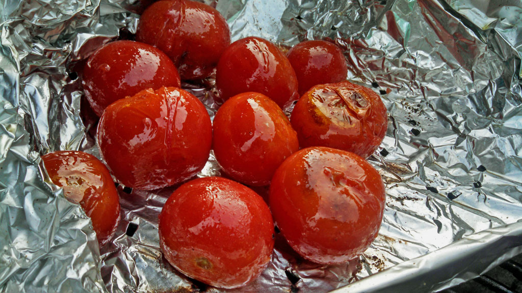 Instead of buying a grilling basket use aluminum foil. Shape the foil into the shape of a box, place on the grill, and poke holes in it. An inexpensive fix! | TheMountainKitchen.com