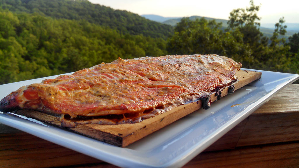 Cedar plank smoked salmon with mountain view