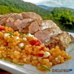 This juicy and tender Greek pork ribeye roast is marinated in a flavorful Greek Dressing and roasted in the oven. It's served with Mediterranean couscous. | TheMountainKitchen.com