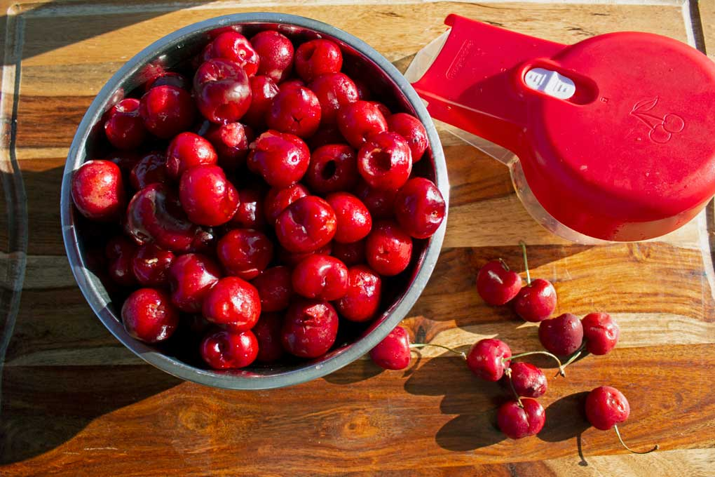 bowl of cherries with pitter