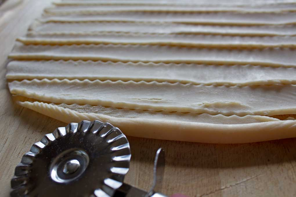 pie crust cut into strips with pastry wheel
