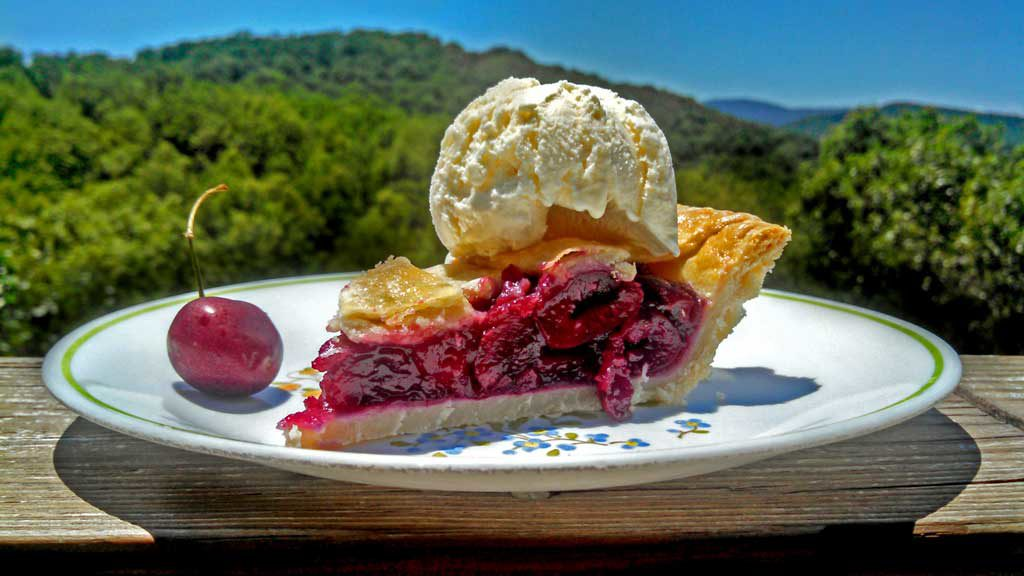 Make homemade cherry pie, with tangy cherries that are just sweet enough, with a hint of almond flavor inside a flaky and buttery crust. Happy 4th of July! | TheMountainKitchen.com