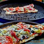 Grilled veggie pizzas are made easy with these step by step directions. The grilled crust is topped with mozzarella cheese, sauce, and vegetable toppings. | TheMountainKitchen.com