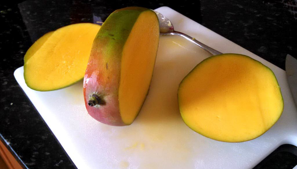 mango sliced into three pieces