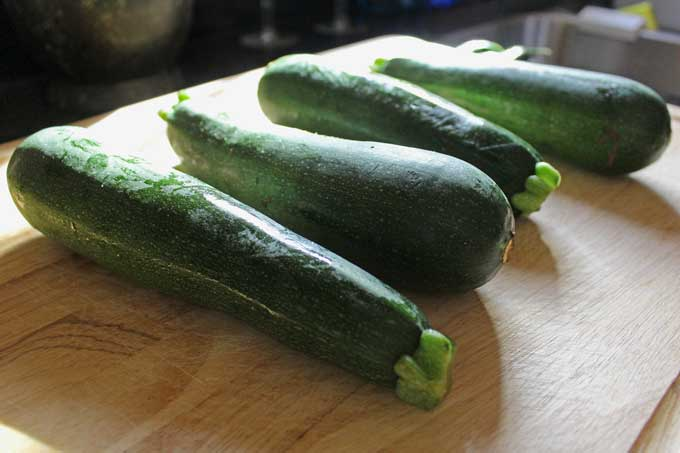 zucchini on carving board