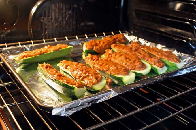 meatless Mexican zucchini boats on sheet pan in oven