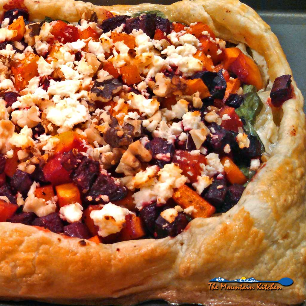 Butternut Squash and Beet Tart ~ beets, butternut squash, feta, walnuts, and spinach on a pastry crust, with ricotta, and balsamic maple cinnamon dressing. | TheMountainKitchen.com