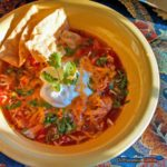 Inspired by Ina Garten, this Mexican chicken soup is made in the crock-pot. This soup is filled with chicken, vegetables, and Mexican flavors you'll love!   TheMountainKitchen.com