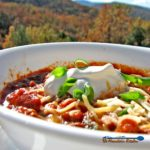 Our slow cooker chili is made in a crock-pot with chunks steak and ground beef, beans, tomatoes, fresh chili sauce and even some coffee for extra richness. | TheMountainKitchen.com
