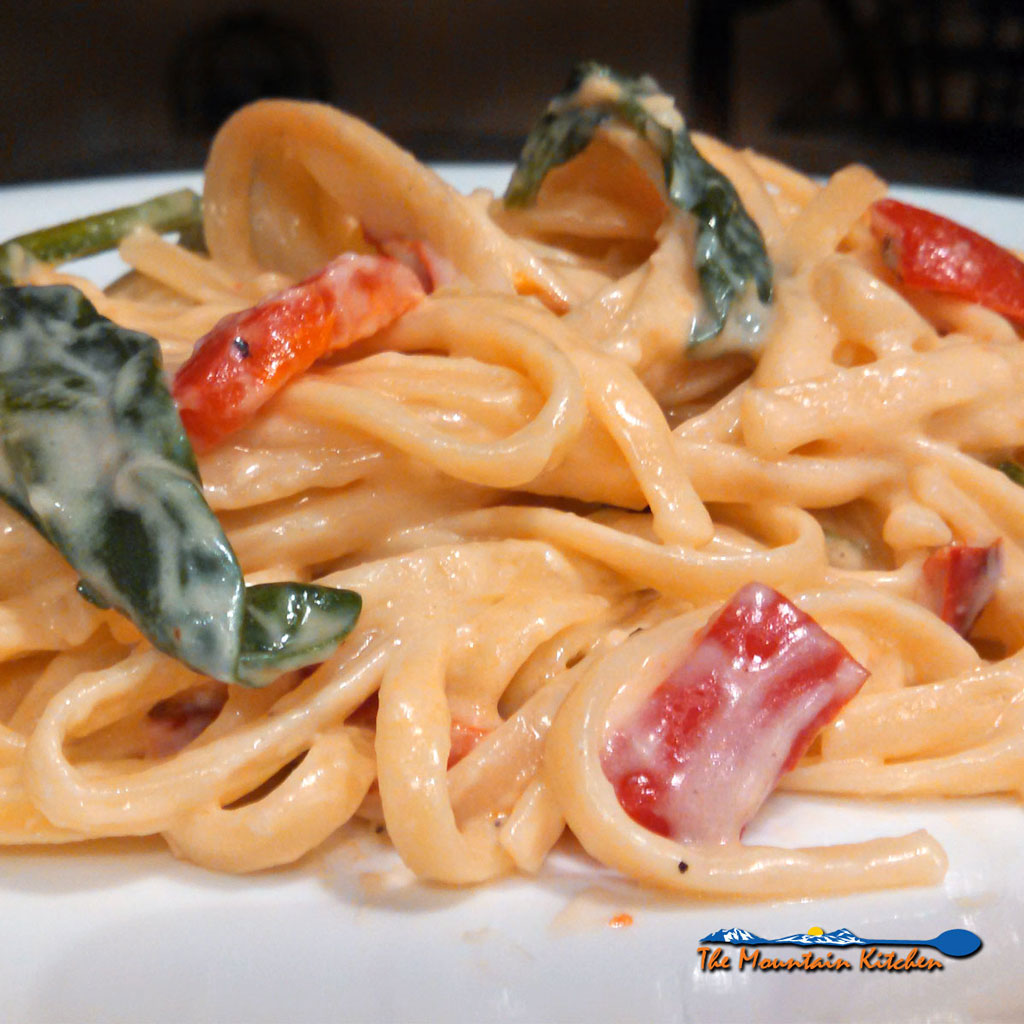 Red Pepper Spinach Linguine With Parmesan Cream Sauce with roasted red peppers, as the base of a parmesan cheese cream sauce with linguine and spinach. | TheMountainKitchen.com