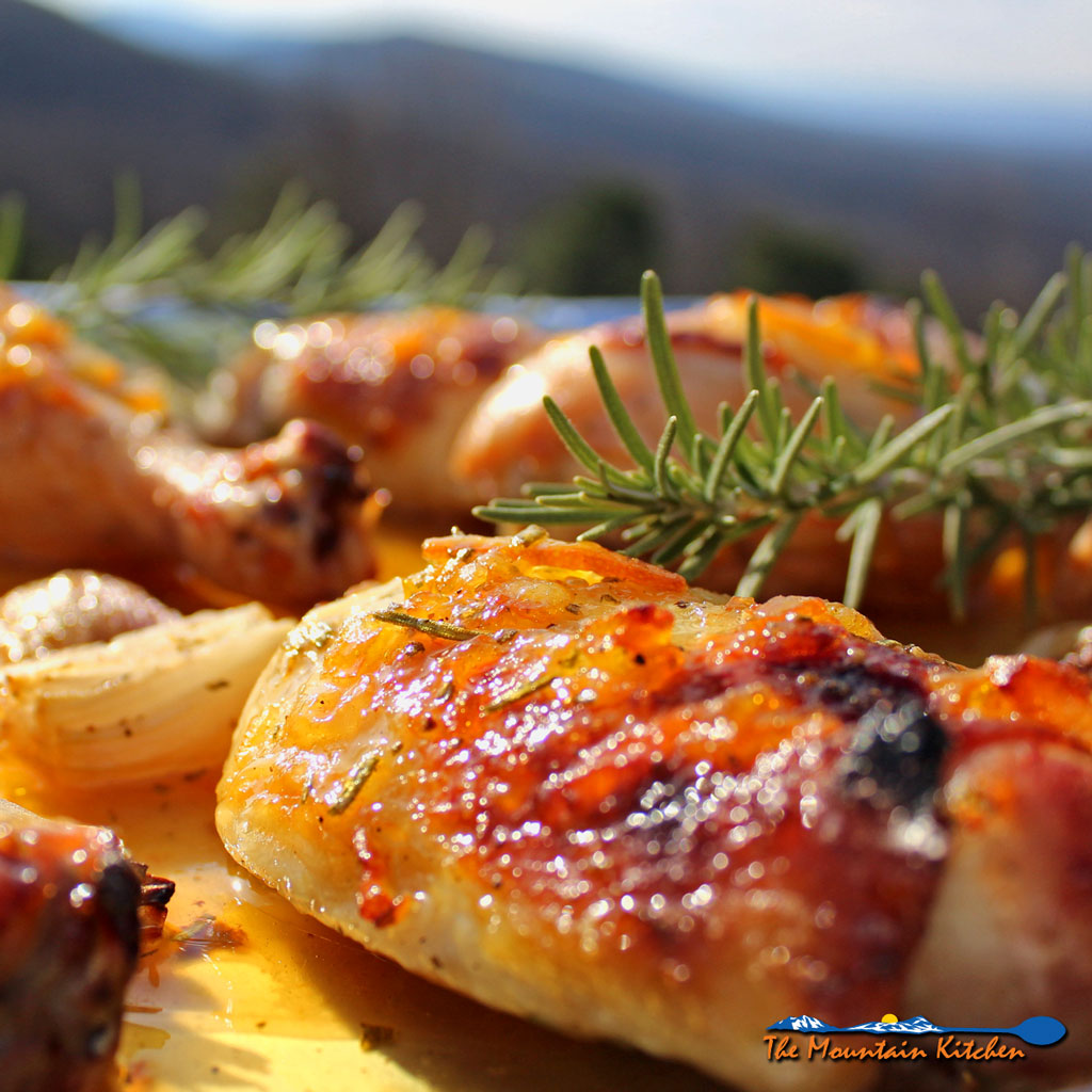Inspired by Julia child, this Chicken À L'Orange uses a sweet and savory chicken roasted with shallots and basted with a rosemary, orange marmalade glaze. | TheMountainKitchen.com