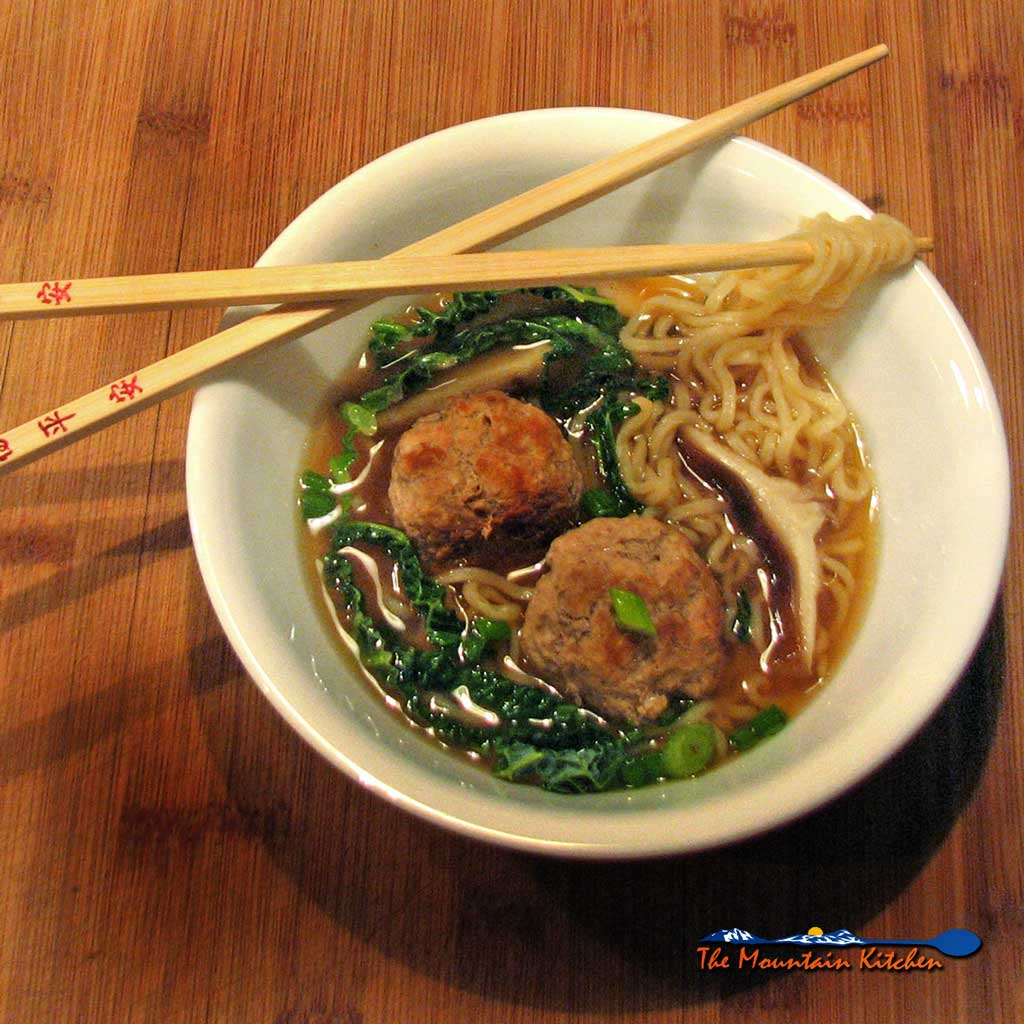 This Asian inspired pork ramen noodle soup has caramelized pork meatballs and ramen noodles in a rich broth flavored with soy sauce and warm ginger. | TheMountainKitchen.com