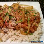 Bubba's Sour Cream Pork Chops are made with onions and mushrooms braised in a flavorful broth with tangy sour cream, served over rice or egg noodles. | TheMountainKitchen.com