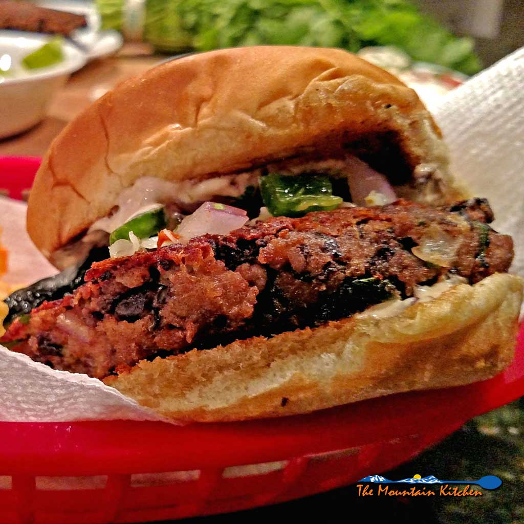 Pepper Jack Black Bean Burgers with a Tex/Mex flare. Red onion, fresh cilantro, and spicy pepper Jack cheese, give these burgers a little extra flavor. | TheMountainKitchen.com