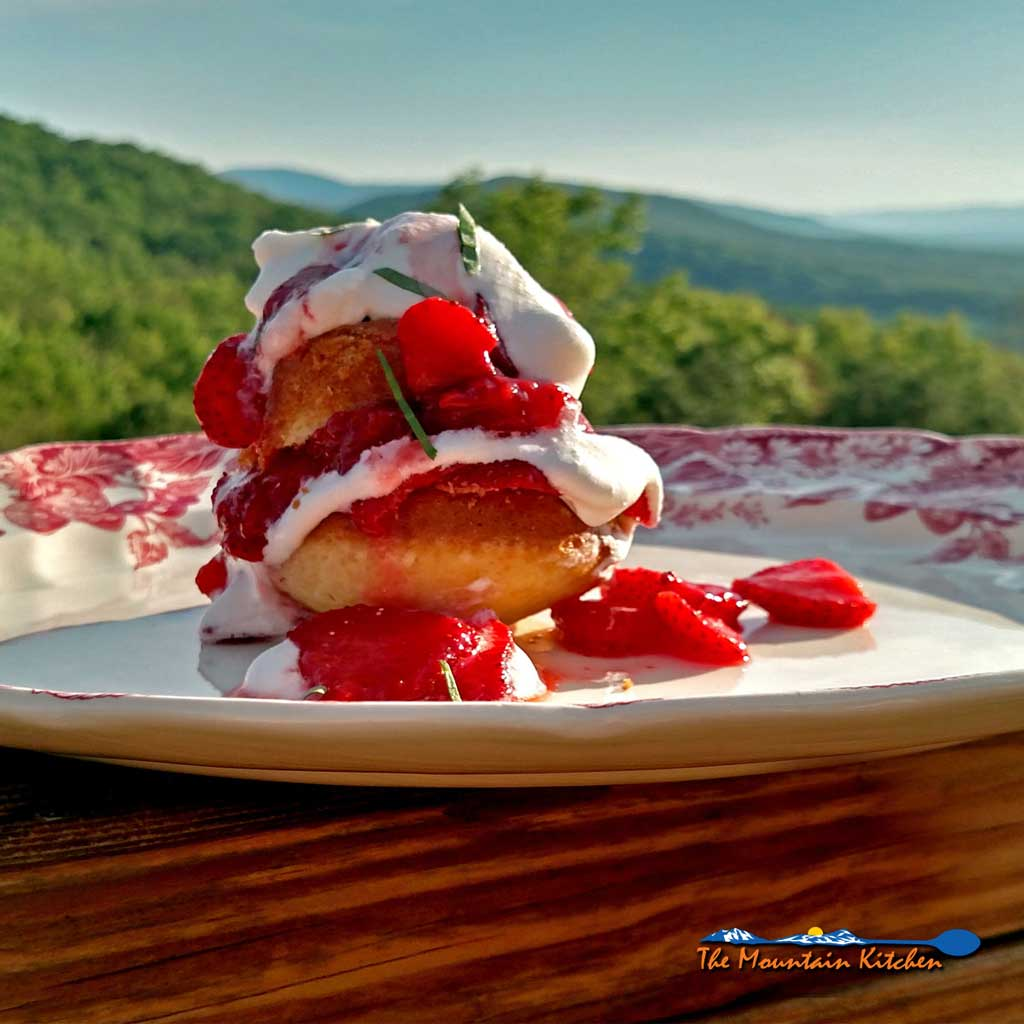 Strawberry Shortcake Surprise is made with light fluffy shortcake cupcakes covered in thick syrupy strawberry compote, fresh strawberries and whipped cream.