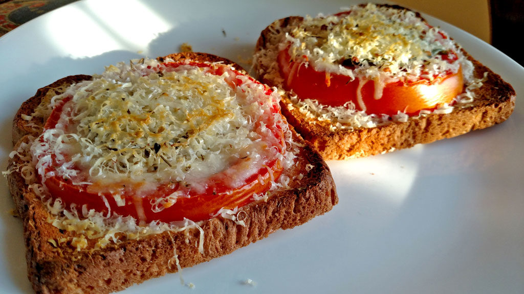 This open-face Caprese Sandwich is perfect for a quick summer meal, toasted bread with tomato slices, basil, mozzarella and parmesan cheese.   TheMountainKitchen.com