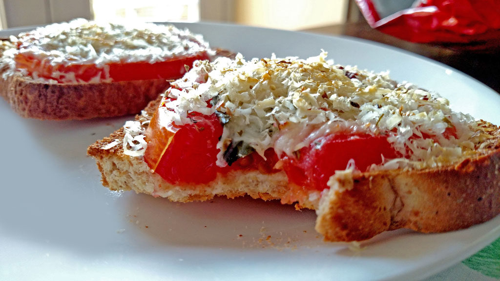 This open-face Caprese Sandwich is perfect for a quick summer meal, toasted bread with tomato slices, basil, mozzarella and parmesan cheese.