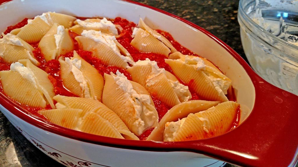 Using both homemade sauce and ricotta cheese, this Meatless Monday ricotta cheese stuffed shells recipe is pure comfort food. You'll forget it's meatless! | TheMeatlessMonday.com