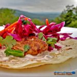 The Mountain Kitchen Fish Tacos are made with seared mahi-mahi, on a tortilla dressed with chipotle sour cream and topped with a light, fresh citrus slaw. | TheMountainKitchen.com