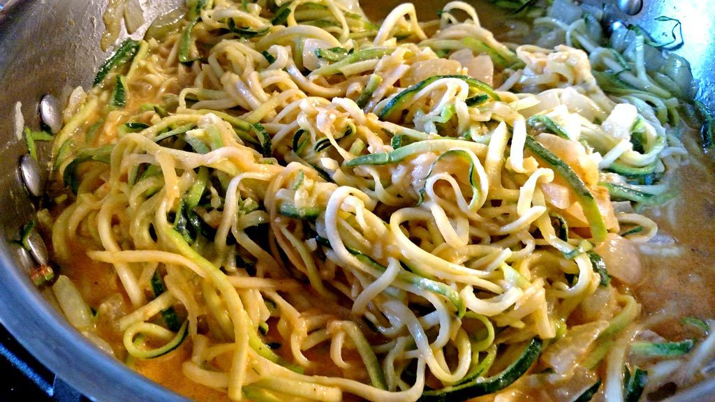 Zucchini noodles with creamy roasted red pepper sauce is a flavorful alternative if you have special dietary needs or just trying to dodge carbs. | TheMountainKitchen.com