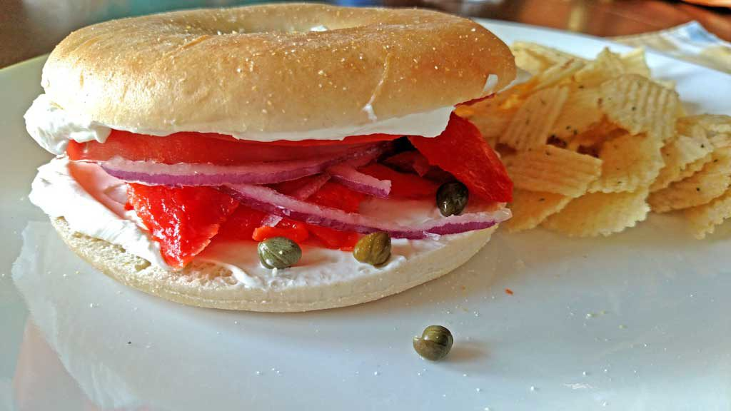 Bagels and lox is a simple sandwich made with chewy bagels smeared with a layer of cream cheese, capers, tomatoes and onion. | TheMountainKitchen.com