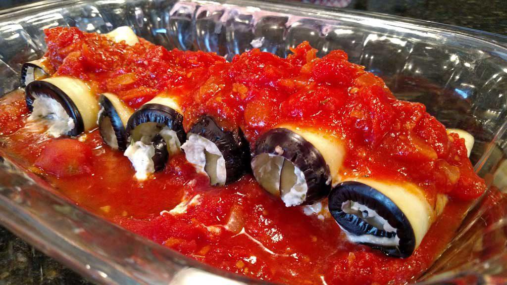 eggplant rollatini with tomato sauce on top