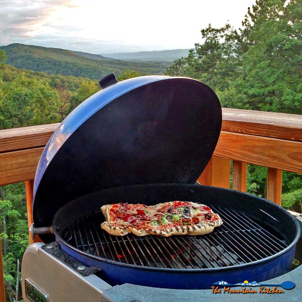 grilled pizza on a charcoal grill. Black Bedroom Furniture Sets. Home Design Ideas