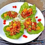Orange Ginger Chicken Lettuce Wraps are made with shredded chicken Basmati rice wrapped in lettuce leaves, with oranges, scallions and drops or sriracha. | TheMountainKitchen.com
