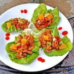 Orange Ginger Chicken Lettuce Wraps on a plate
