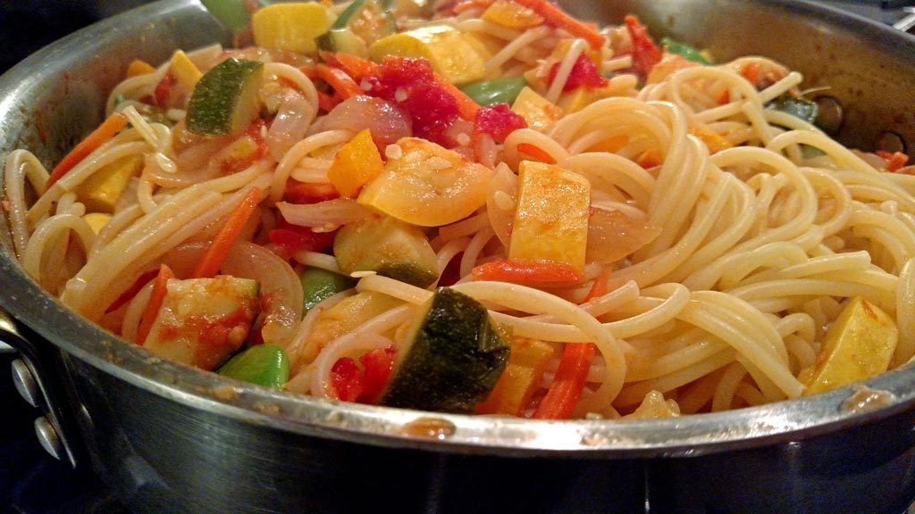 This Pasta Primavera will be a meatless favorite, with fresh zucchini, summer squash, peppers, mushrooms and tomatoes tossed with pasta and goat cheese. | TheMountainKitchen.com